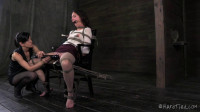 Elise ties leather around her toes and pulls her into a more severe hogtie