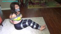 Desperate escape attempt in duct tape bondage