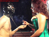 Mistress Mellie D Smoking And Dominating Male Slave