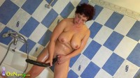 Mature using dildo in shower
