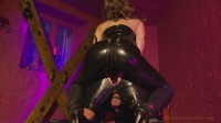 She flogs her slave over his peachy buttocks and torso while he hangs, she stuns his cock and balls w