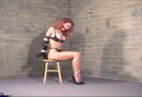 See her attempt to move her hands and loosen the rope
