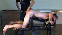 Gagged, tied to a spanking bench, underwear cut off him, arse caned till his arse burns red