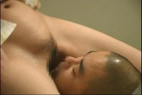 Beautiful japanese girl peeing into mouth during facesitting