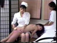 Binky is spanked by each nurse in turn, has her rectal temperature taken