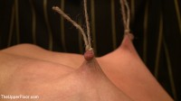 Eager slut submits to nipple torture and orgasms in strenuous bondage.