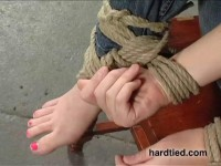 Hair ties, toe ties, and a nose hook spice up the bondage
