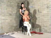 She looks helpless while seated on the floor with her body tied with rope