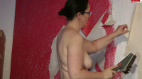 huge booty wife in leather painting the wall