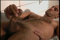Download  Carlo Morales Goes Solo In The Hot Shower Scene.