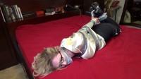 Hot blonde secretary hogtied on a bed