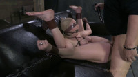 Farmers girl bound in leather and chains on the squirt couch
