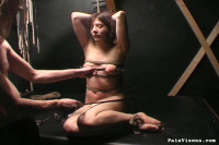 This young lady is so helpless. Shes naked and bound in rope by a captor
