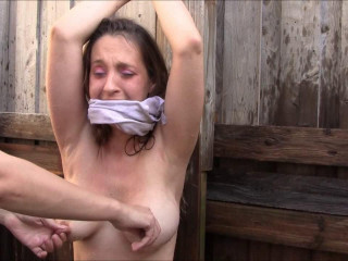 Restrain bondage and water torment for naked woman on the outdoor