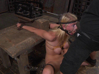 Allie James is locked into a automatic blow job machine