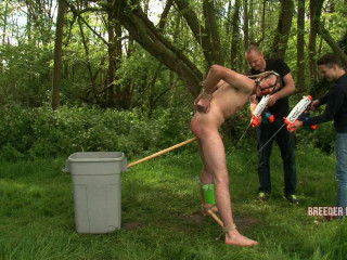 Hung nude in the forest, nailed with a fake penis on a stick, culo and ball sack flogged