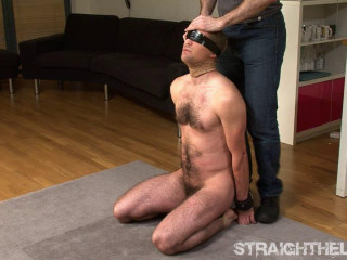 Blindfolded, electric shock collar