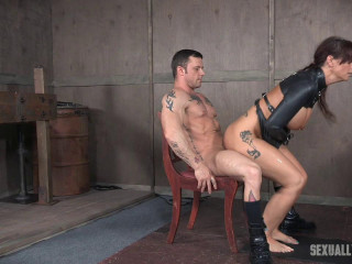 Hot Milf is defenseless in a straitjacket