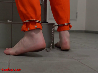 I love Bondage - Female prisoner cuffed and shackled