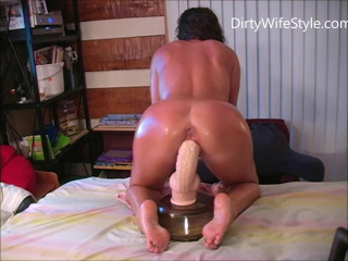 More naked and oiled dildo riding