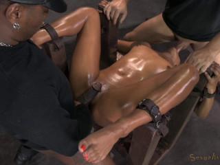 Redheaded slut Daisy Ducati bound down and fucked hard by 2 big cocks