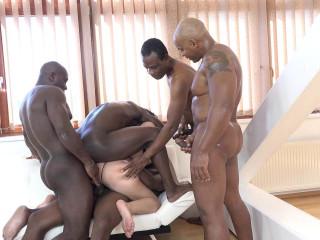 Sexy milf whore enjoys five black cocks in gangbang