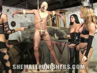 Spandex Clothed Slave Manhandled In The Basement