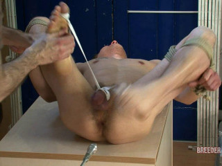 Bound with his arse spread, feet menaced, made to deep throat a dildo