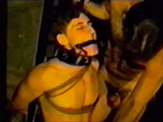 Peter is instructed to serve sexually while trussed with strap and ball-gagged with
