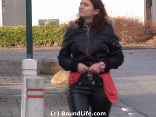 Outdoors in latex, leather, and chastity