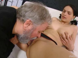Diana moans as this grey haired fellows gobbles her youthfull wooly pussy.
