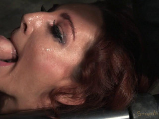 Savannah Fox chained to a sybian saddle and deep throated