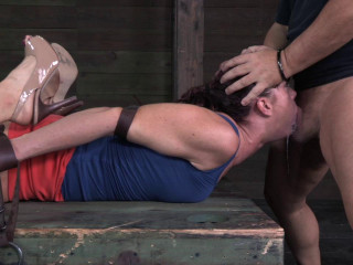 Lanky fit redhead Cici Rhodes hogtied on a box and made to service cocks!