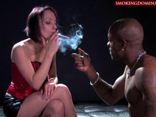Mistress Paige Fox Blows Her Smoke In Her Slaves