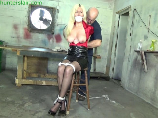 Stretched up by her brutally bound tits