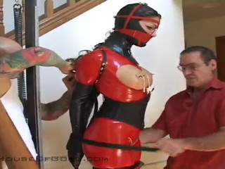 Tight bondage, domination and torture for sexy model in latex