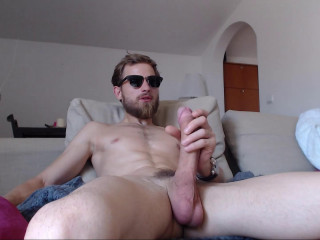 Man with a big dick masturbates in front of webcam