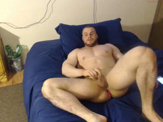 Bodybuilder with toy in ass