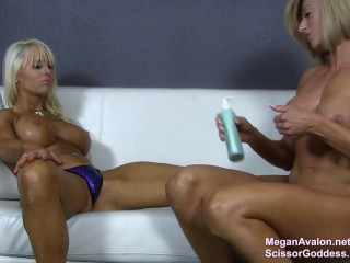 Muscle damsels Megan Avalon and Princess Rapture adore each others soles