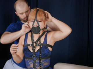Harnessed Blindfolded and Secured