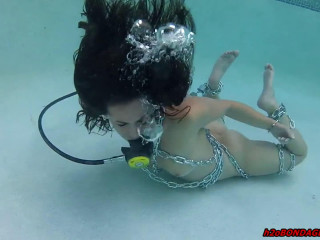 Extraordinary bondage and frogtie for naked dame in the swimming pool
