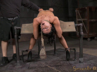 Lithe London River trussed to a sybian saddle in a violent backarch and throatboarded by hard cock!
