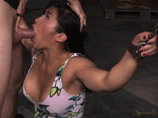 Big breasted Mia Li bent over, chained down
