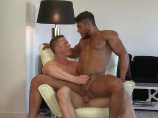 In a muscular embrace