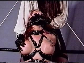 So, he tied her tighter and ball-gagged her more with a larger cloth