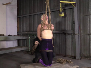 Brendas Bondage - They Turn Purple As She Hangs By Her Bound Breast