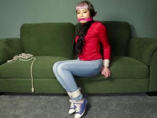 Raina in Jeans and Sofa
