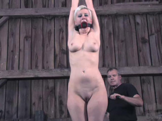 She is being whipped into subjugation and made to deep-throat chisel