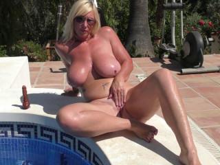 British big breasted Melody Charm having fun at the pool