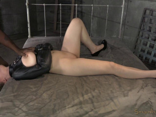 Jessica Ryan trussed in a straightjacket